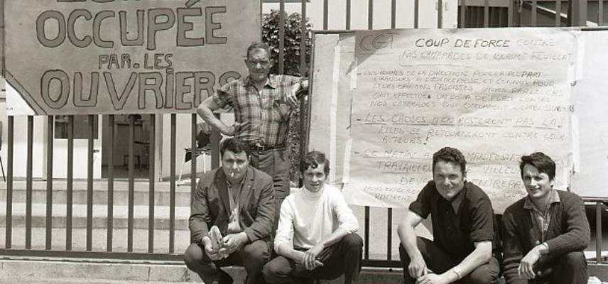 french workers with placard during occupation of their factory